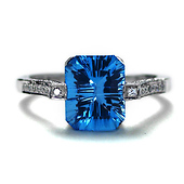 3ct Emerald-Cut Blue Topaz Ring in 14K White Gold with Side Diamonds