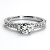 18k WG Round Center Engagement Ring w/ Baguette and Round Sidestones .61 ct center, 0.25ct side